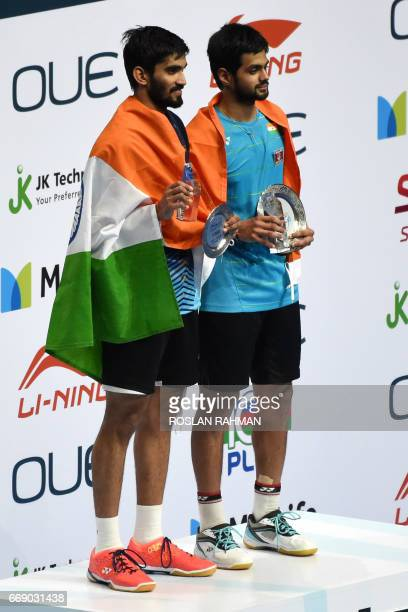 Winner Sai Praneeth of India poses with secondplaced compatriot Srikanth Kidambi after their men's singles finals of the Singapore Open badminton...