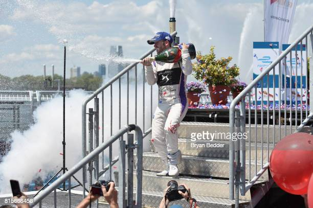 Winner Sam Bird of DS Virgin Racing with GH Mumm Champagne celebrates Formula E with Mumm Grand Cordon at the inaugural ePrix Race on July 16 2017 in...