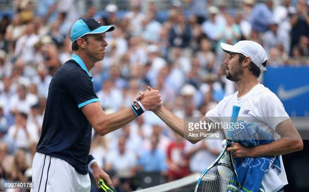 Winner Sam Querry of The United States shakes hands with runner up Jordan Thompson of Australia on day four of the 2017 Aegon Championships at Queens...