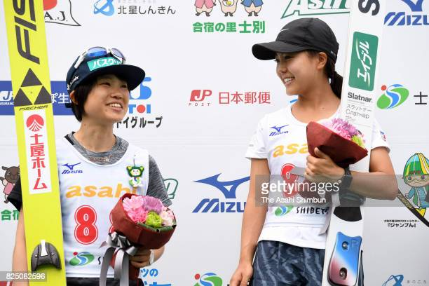 Winner Sara Takanashi and runnerup Yuki Ito celebrate at the award ceremony during the All Japan Junior Ladies Summer Ski Jumping Championships at...