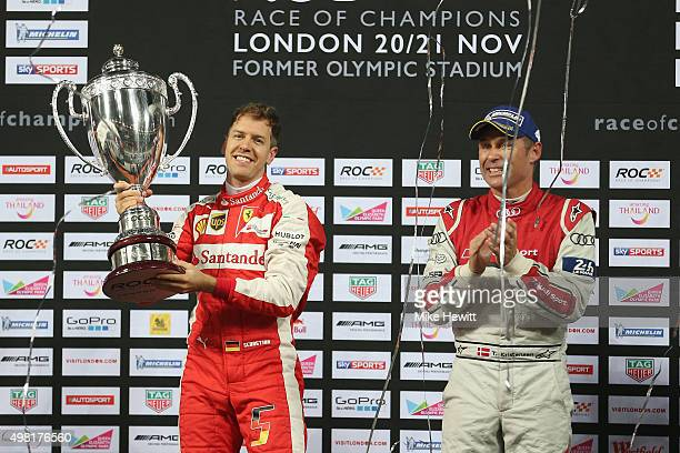 Winner Sebastian Vettel of Germany is applauded by runner up Tom Kristensen of Denmark after winning the Race of Champions at the Olympic Stadium on...