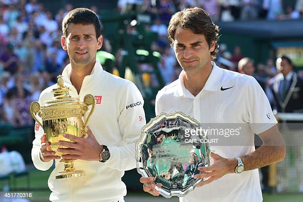 Winner Serbia's Novak Djokovic and runnerup Switzerland's Roger Federer hold their trophies during the presentation at the end of their men's singles...