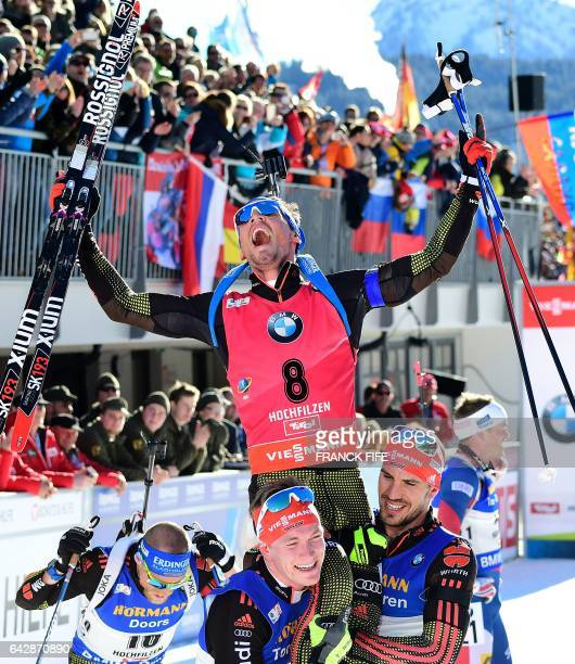 Winner Simon Schempp of Germany celebrates his victory in the finish area after the 2017 IBU World Championships Biathlon Men's 15 km Mass start race...