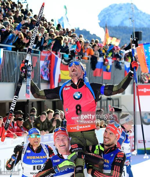 Winner Simon Schempp of Gremany celebrates in the finish area after the 2017 IBU World Championships Biathlon Men's 15 km Mass start race in...