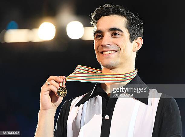 Winner Spain's Javier Fernandez poses with his medal during the winners ceremony of the men's free skating competition of the European Figure Skating...