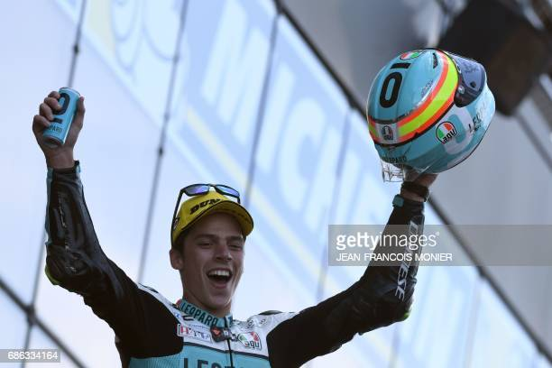Winner Spain's rider Joan Mir celebrates with his trophy on the podium after the Moto3 race of the French Motorcycle Grand Prix on May 21 2017 in Le...
