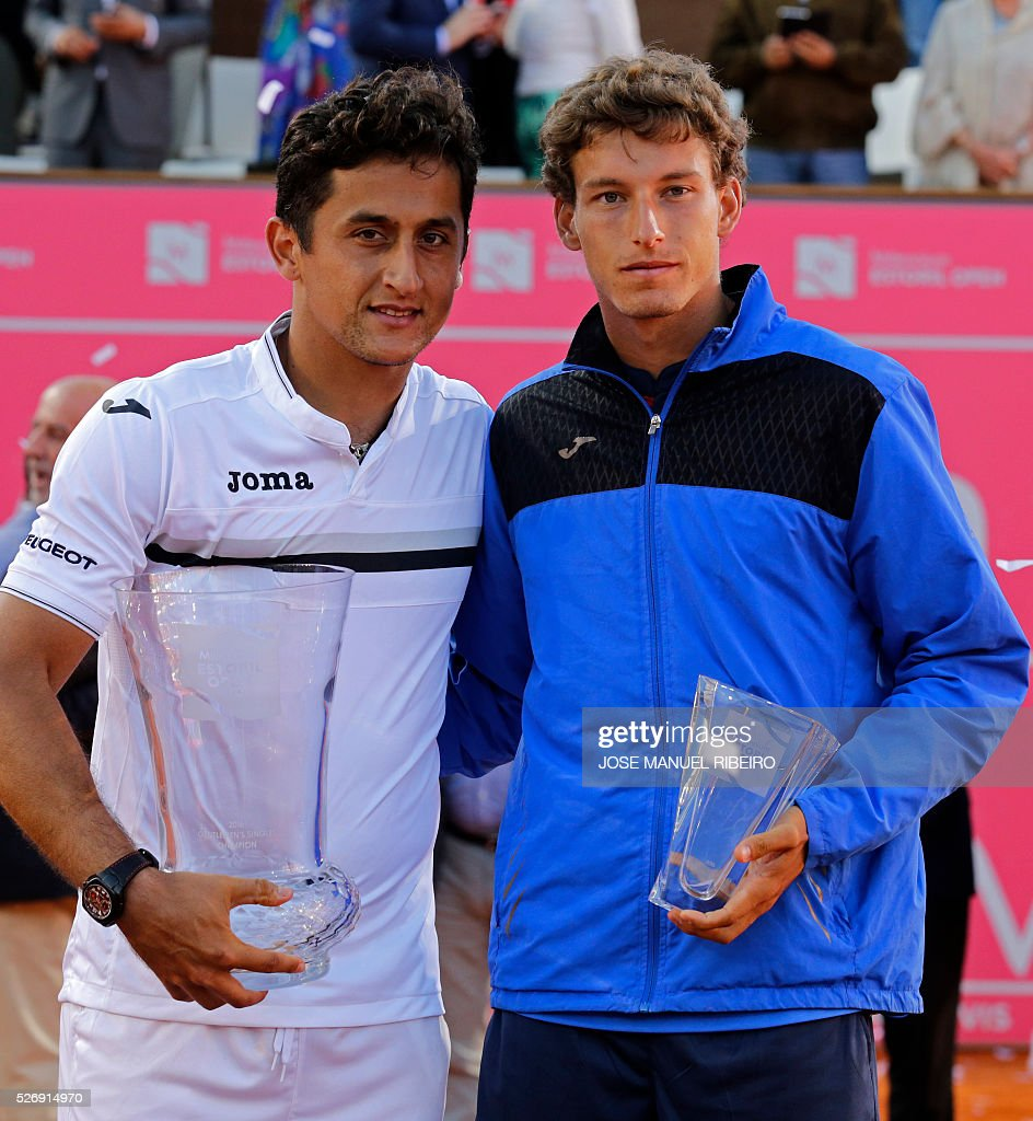 Winner Spanish player Nicolas Almagro (L) poses with Pablo Carreno Busta on the podium of the Estoril Open Tennis tournament in Estoril on May 1, 2016. Spanish player Nicolas Almagro won 6-7, 7-6 and 6-3. / AFP / JOSE