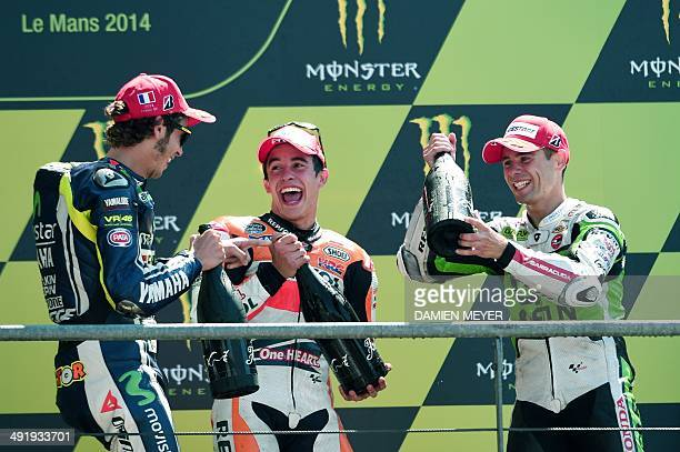 Winner Spanish rider Marc Marquez flanked by secondplaced Italian rider Valentino Rossi and thirdplaced Spanish rider Alvaro Bautista celebrate on...