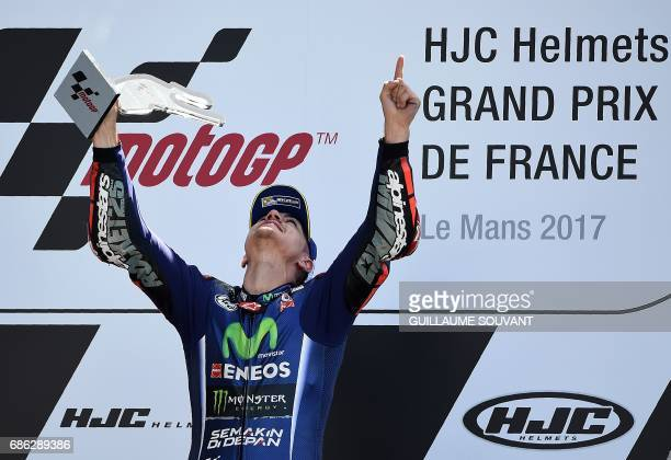 Winner Spanish's rider Maverick Vinales jubilates on the podium at the MotoGP race of the French Motorcycle Grand Prix on May 21 2017 in Le Mans...