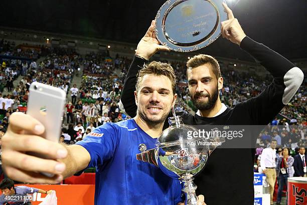 Winner Stan Wawrinka of Switzerland and runnerup Benoit Paire of France take a selfie after the men's singles final match on Day Seven of the Rakuten...