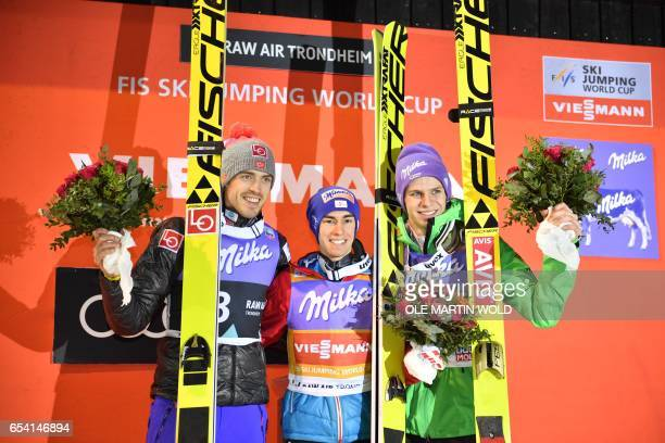 Winner Stefan Kraft from Austria flanked by second placed Andreas Stjernen from Norway and third placed Andreas Wellinger from Germany after the FIS...