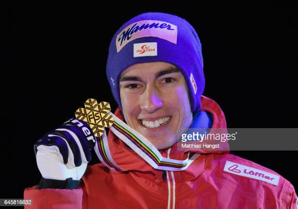 Winner Stefan Kraft of Austria poses with his medal during the award ceremony after the Men's Ski Jumping HS100 at the FIS FIS Nordic World Ski...