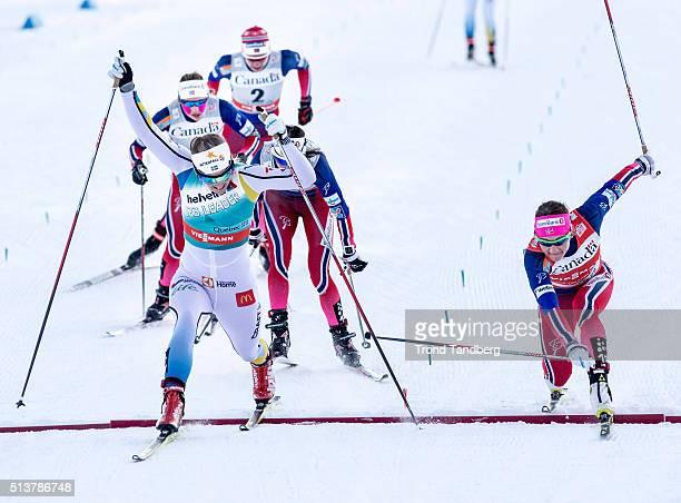 Winner Stina Nilsson of Sweden crosses the finish line ahead of Maiken Caspersen Falla of Norway during Cross Country Ladies 15 km Sprint Free...