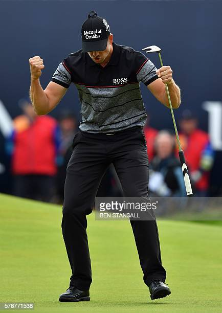 Winner Sweden's Henrik Stenson celebrates making his birdie putt on the 18th green during his final round 63 to win the Championship on day four of...