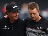 Winner Sweden's Henrik Stenson consoles runnerup US golfer Phil Mickelson on the 18th green after shooting 63 in his final round to win the...