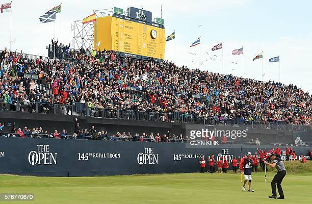 Winner Sweden's Henrik Stenson reacts after making his birdie putt on the 18th green during his final round 63 to win the Championship on day four of...
