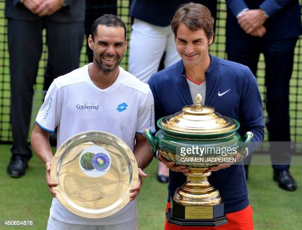 Winner Swiss tennis player Roger Federer and Alejandro Falla from Columbia hold their trophies after their final match at the ATP Gerry Weber Open...