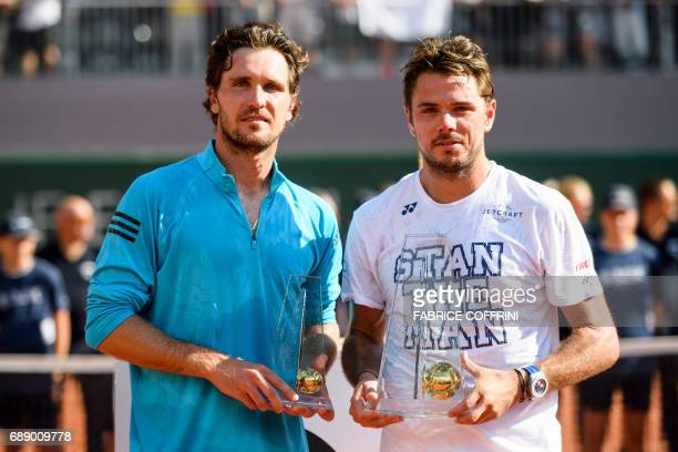 Winner Swiss tennis player Stan Wawrinka poses with German tennis player Mischa Zverev after their final game at the Geneva Open ATP 250 Tennis...