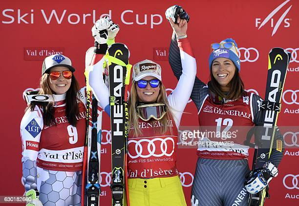 Winner Switzerland's Lara Gut secondplaced Lichtenstein's Tina Weirather and thirdplaced Italy's Elena Curtoni celebrate on the podium after the FIS...