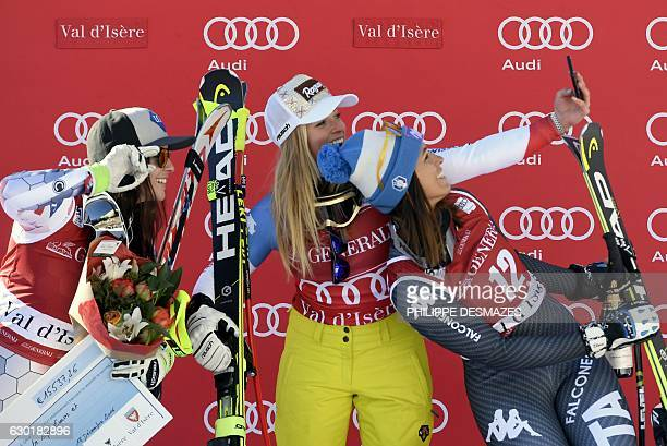Winner Switzerland's Lara Gut secondplaced Lichtenstein's Tina Weirather and thirdplaced Italy's Elena Curtoni take a selfie as they celebrate on the...