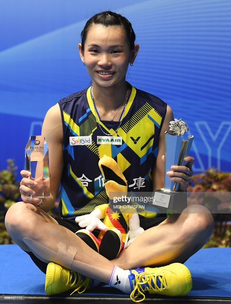 Winner Tai Tzu Ying of Taiwan poses with her trophy on the podium