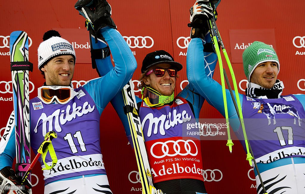 Winner Ted Ligety of US (C) poses on January 12, 2013 on the podium flanked by second placed Germany's Fritz Dopfer (L) and third placed Germany's Felix Neureuther during the ceremony of the Men's giant slalom at the Alpine Skiing World Cup in Adelboden. Ligety claimed victory, safely negotiating a testing second leg that was the downfall of a raft of racers.