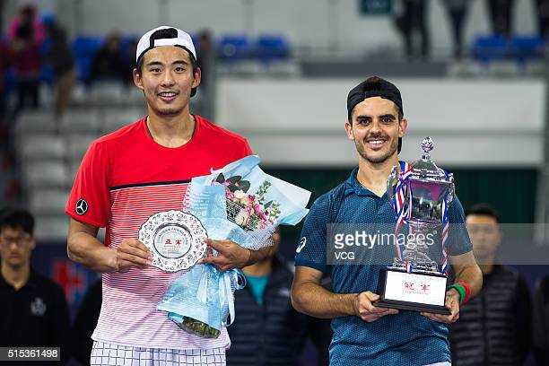 Winner Thomas Fabbiano of Italy and Zhang Ze of China pose with trophies after men's singles final match during 2016 ATP Zhuhai Challenger on March...