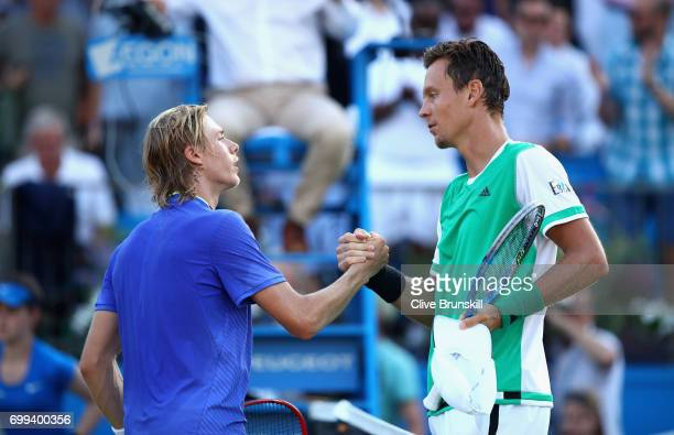 Winner Thomas Berdych of The Czech Republic shakes hands with runner up Denis Shapovalov of Canada on day three of the 2017 Aegon Championships at...