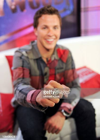 NASCAR Winner Trevor Bayne poses with his Daytona 500 Winners Ring during a visit to YoungHollywoodcom at Young Hollywood Studio on February 23 2011...