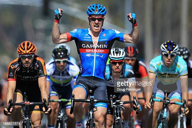 Winner Tyler Farrar of the USA riding for GarminSharp celebrates as Ken Hanson of the USA riding for Optum p/b Kelly Benefit Stategies finishes...