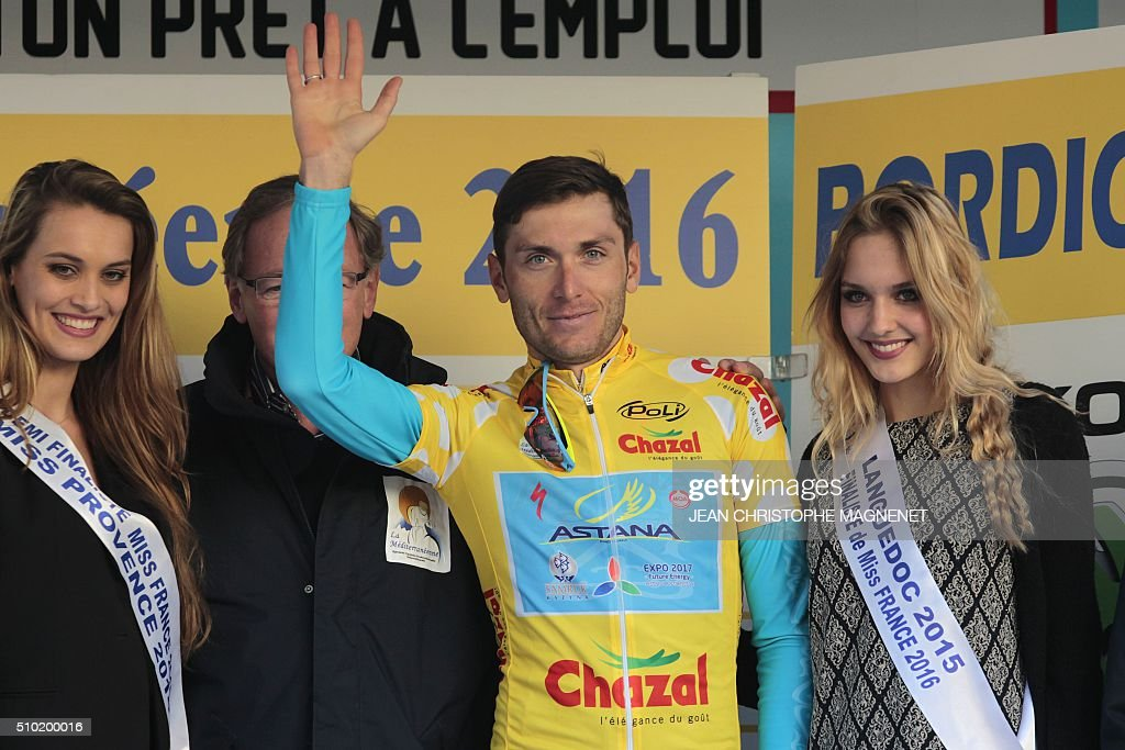 Winner, Ukrainian cyclist Andriy Grivko of Astana team celebrates on the podium following the first edition of The Mediterranean cyclist (La Méditerranéenne cycliste) in the fourth and last stage (95.7 km), on February 14, 2016, in the Italian city of Bordighera. / AFP / JEAN CHRISTOPHE MAGNENET