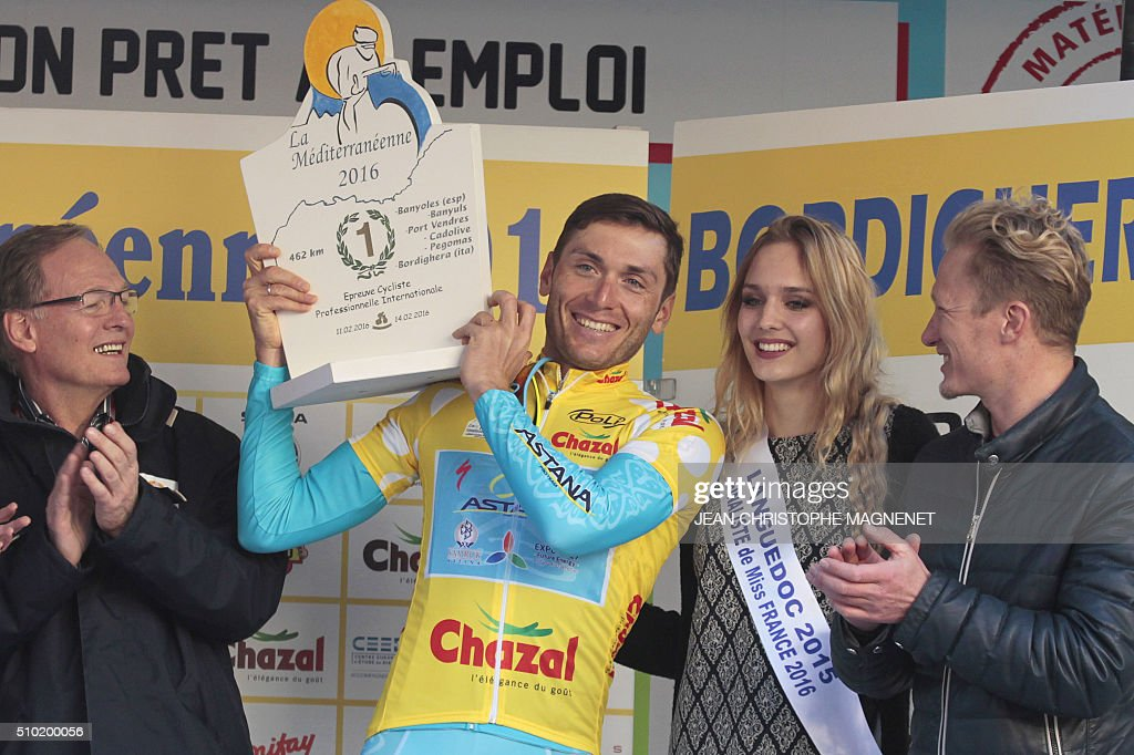 Winner, Ukrainian cyclist Andriy Grivko of Astana team, celebrates on the podium following the first edition of The Mediterranean cyclist (La Méditerranéenne cycliste) in the fourth and last stage (95.7 km), on February 14, 2016, in the Italian city of Bordighera. / AFP / JEAN CHRISTOPHE MAGNENET