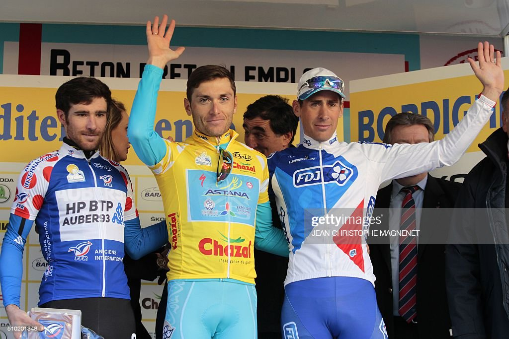 Winner Ukrainian cyclist Andriy Grivko of Astana team (C), second placed French cyclist Matthieu Ladagnous of FDJ team (R) and French cyclist Romain Feillu of HP BTP-Auber 93 team (L) combativeness prize, celebrates on the podium following the first edition of The Mediterranean cyclist (La Méditerranéenne cycliste) in the fourth and last stage (95.7 km), on February 14, 2016, in the Italian city of Bordighera. / AFP / JEAN CHRISTOPHE MAGNENET
