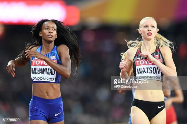 Winner US athlete Dalilah Muhammad and second place Canada's Sage Watson at the finish of a semifinal of the women's 400m hurdles athletics event at...