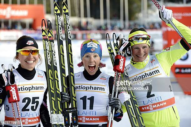 Winner US Kikkan Randall 2nd placed Katja Visnar of Slovenia and 3rd placed Sophie Caldwell celebrate after competing in the Women's CrossCountry...