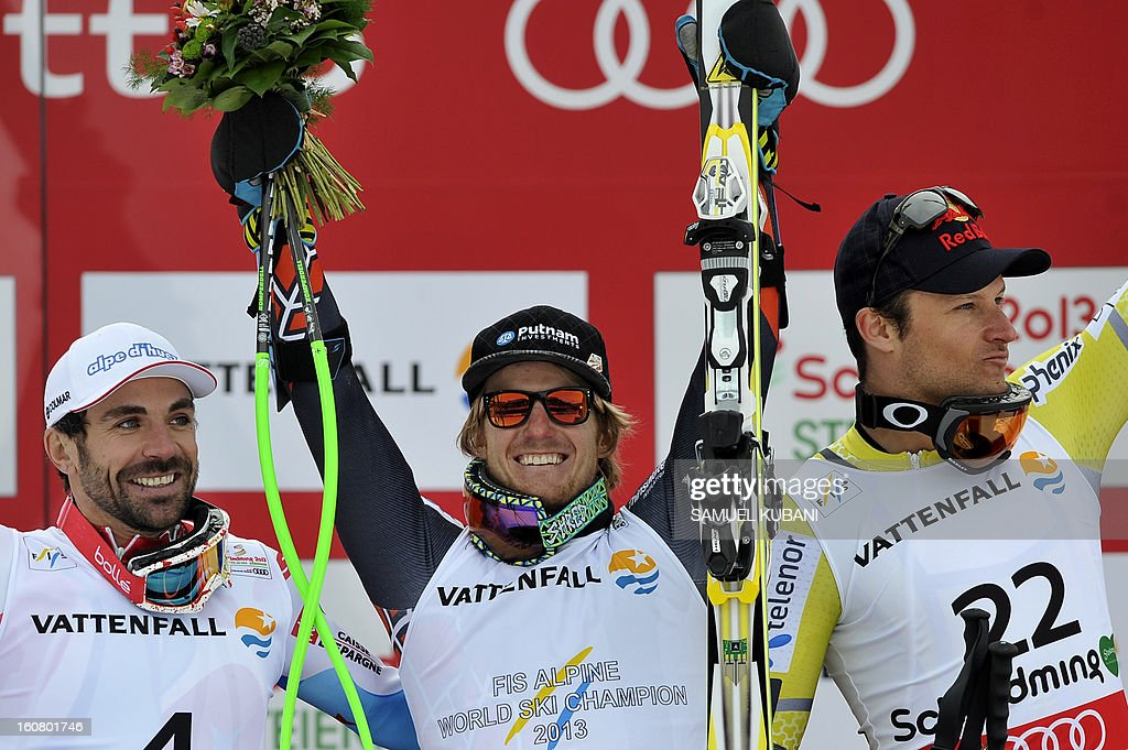 Winner US Ted Ligety (C), second placed France's Gauthier De Tessieres (L) and third placed Norway's Alsel Lund Svindal celebrate on the podium after the men's Super-G event of the 2013 Ski World Championships in Schladming, Austria on February 6, 2013.