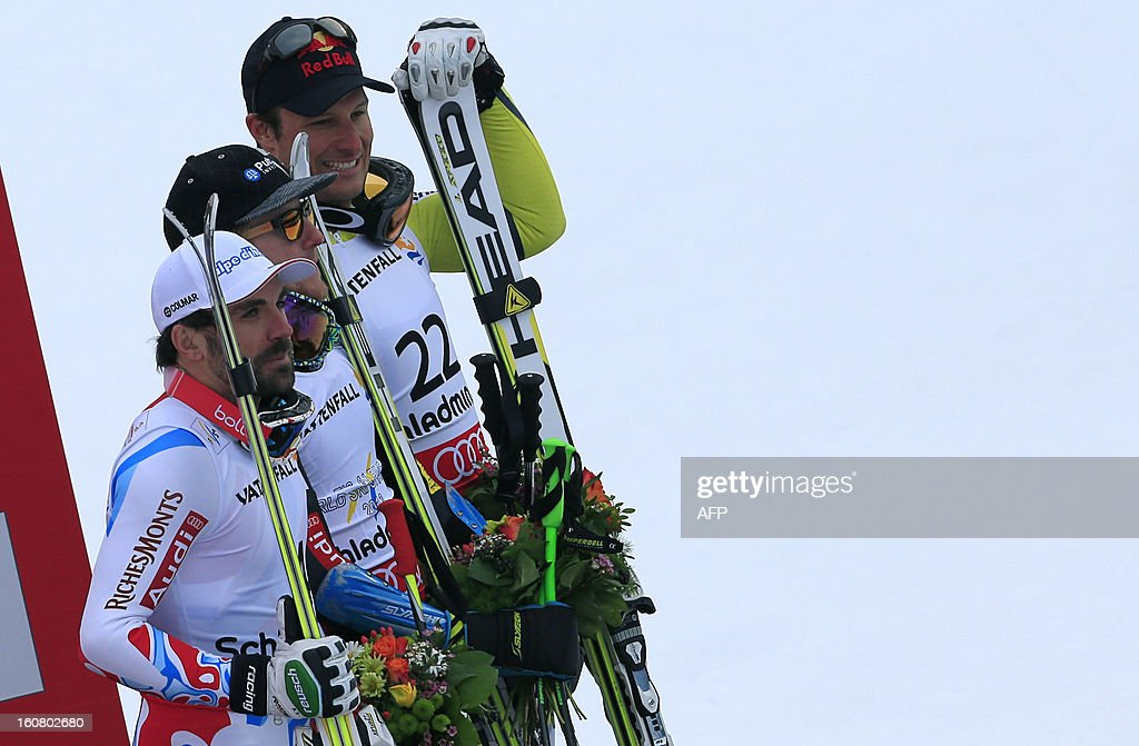 Winner US Ted Ligety (C), second placed France's Gauthier De Tessieres (L) and third placed Norway's Alsel Lund Svindal (R) celebrate on the podium after the men's Super-G event of the 2013 Ski World Championships in Schladming, Austria on February 6, 2013 AFP PHOTO / ALEXANDER KLEIN