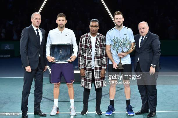 Winner USA's Jack Sock poses with the trophy next to second placed Serbia's Filip Krajinovic Paris Masters director Guy Forget French judoka Audrey...