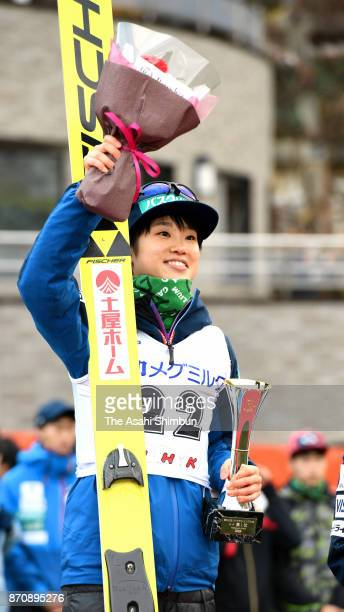 Winner Yuki Ito celebrates on the podium at the medal ceremony for the Women's event during the 96th All Japan Ski Championships Ski Jumping at...