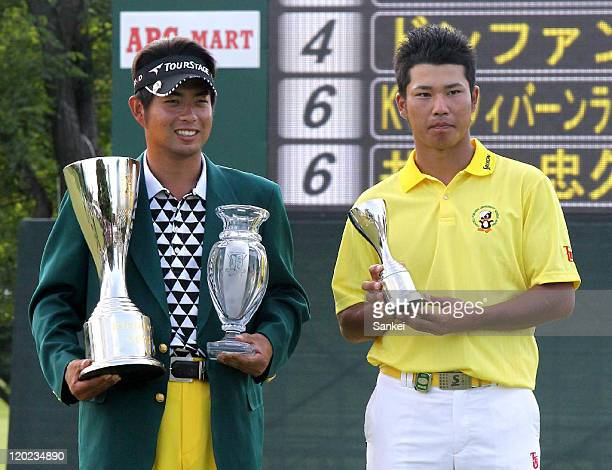 Winner Yuta Ikeda and Low Amateur Hideki Matsuyama pose for photographs after the final round of the Sun Chlorella Classic at Otaru Country Club on...