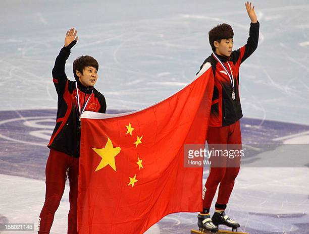 WinnerMeng Wang of China 2nd PlaceKexin Fan of China hold national flag to celebrate after the Women's 500m Final during the day two of the ISU World...