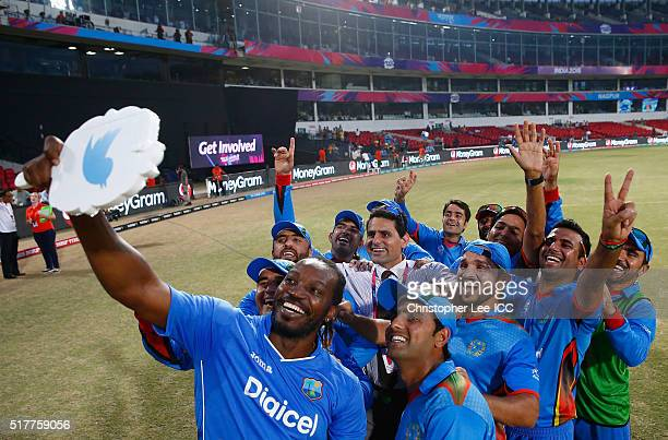 Winners Afghanistan get a selfie picture with Chris Gayle of the West Indies during the ICC World Twenty20 India 2016 Group 1 match between...