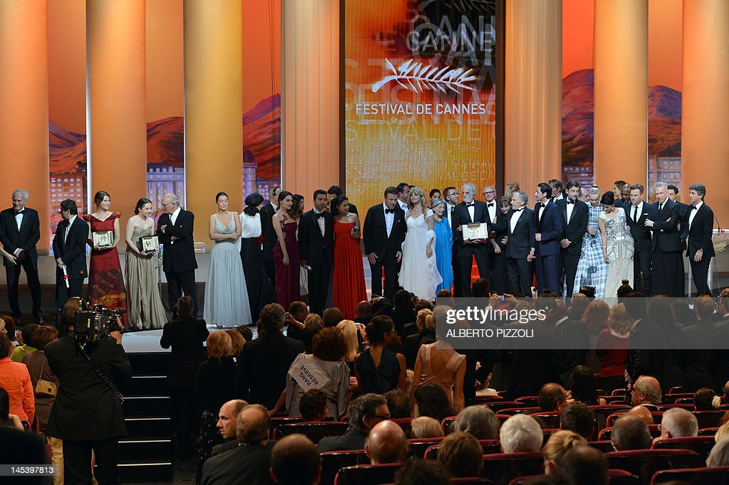Winners and hosts stand on stage after Austrian director Michael Haneke (C) won the Palme d'Or for his film 'Amour' during the closing ceremony of the 65th Cannes film festival on May 27, 2012 in Cannes.