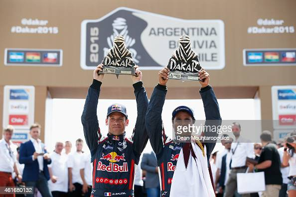 Winners and now Dakar champions #301 Nasser Al Attiyah of Qatar and Mathieu Baumel of France for the ALL4 Racing Mini Qatar Rally Team celebrates the...
