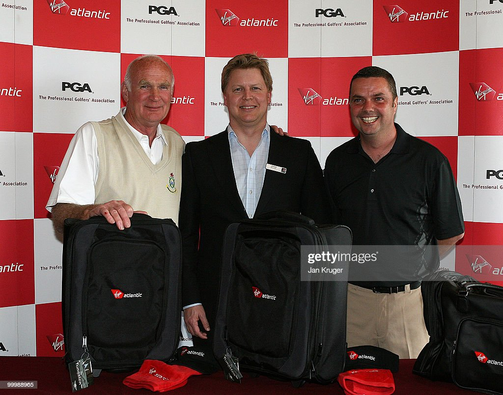 Winners, Andre Roberts (L) and Alex Rowland (R) of Hawarden pose for a picture with James Merchant of Virgin during the Virgin Atlantic PGA National Pro-Am Championship regional final at St Annes Old Links Golf Club on May 19, 2010 in Lytham St Anne's, England.