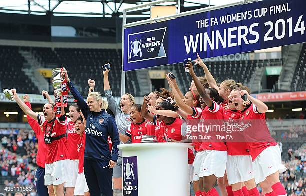Winners Arsenal Ladies celebrate with the trophy during the FA Women's Cup Final match between Everton Ladies and Arsenal Ladies at Stadium mk on...