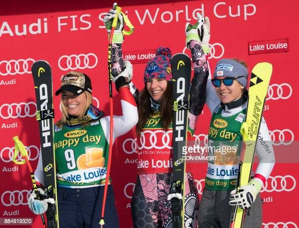 Winners celebrate their victories during the FIS Ski World Cup Women's Super G on December 3 2017 in Lake Louise Canada Lara Gut of Switzerland...