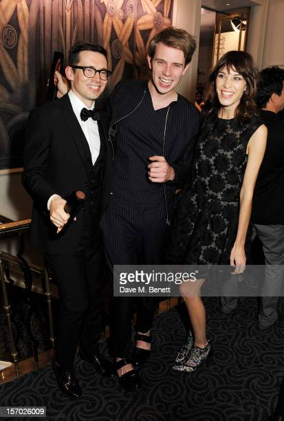 R Winners Erdem Moralioglu Jonathan Anderson and Alexa Chung pose with their awards at the British Fashion Awards 2012 at The Savoy Theatre on...
