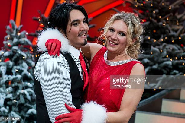 Winners Erich Klann and Magdalena Brzeska embrace after the Final of 'Let's Dance Let's Christmas' TV Show on December 21 2013 in Cologne Germany
