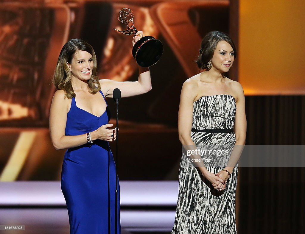 Winners for Best Writing for a Comedy Series <a gi-track='captionPersonalityLinkClicked' href=/galleries/search?phrase=Tina+Fey&family=editorial&specificpeople=206753 ng-click='$event.stopPropagation()'>Tina Fey</a> and Tracey Wigfield speak onstage during the 65th Annual Primetime Emmy Awards held at Nokia Theatre L.A. Live on September 22, 2013 in Los Angeles, California.